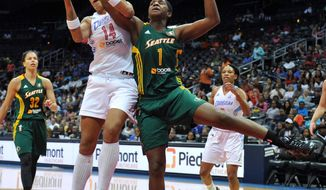 Atlanta Dream's Erika de Souza and Seattle Storm's Crystal Langhorne vie for a rebound during a WNBA basketball game Friday, May 30, 2014, in Atlanta. (AP Photo/Atlanta Journal Constitution, Brant Sanderlin) GWINNETT OUT  MARIETTA OUT   LOCAL TV OUT (WXIA, WGCL, FOX 5)