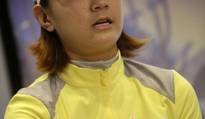 Na Yeon Choi, of South Korea, answers a reporters question after finishing the first round of the ShopRite LPGA Classic golf tournament in Galloway Township, N.J., Friday, May 30, 2014. . (AP Photo/Mel Evans)