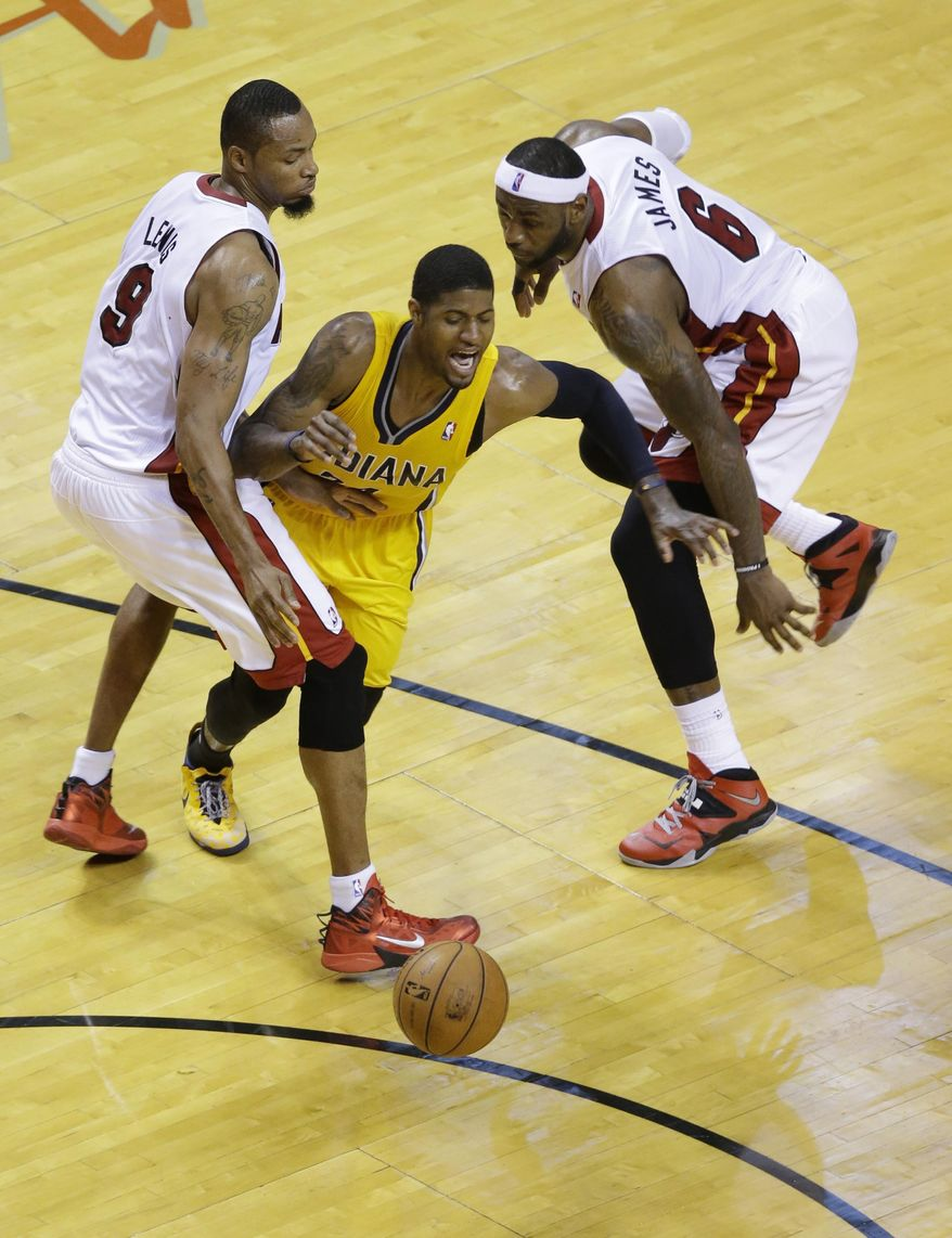 Miami Heat forward LeBron James (6) slaps the ball from Indiana Pacers forward Paul George, center, as Heat forward Rashard Lewis (9) defends during the second half of Game 6 in the NBA basketball playoffs Eastern Conference finals on Friday, May 30, 2014, in Miami. (AP Photo/Wilfredo Lee)