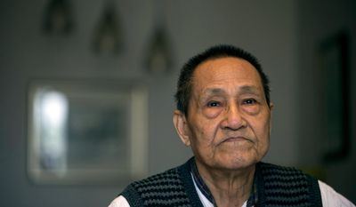 In this April 23, 2014 photo, Bao Tong, aide to the late reform-minded former Communist Party general secretary, Zhao Ziyang, speaks from his home in Beijing, China.  After the June 4, 1989, military crackdown to end weeks-long student protests, Bao was imprisoned for seven years. Since his release in 1996, he has lived under house arrest, his moves observed, his visitors screened by security services who sit at a desk in the lobby of his high-rise apartment building.  (AP Photo/Ng Han Guan)