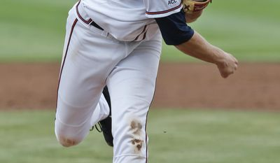 Virginia pitcher Artie Lewicki (34) pitches during the second inning of an NCAA College regional tournament baseball game against Bucknell in Charlottesville, Va., Friday, May 30, 2014.   (AP Photo/Steve Helber)