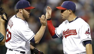 Cleveland Indians relief pitcher Cody Allen, left, celebrates with Asdrubal Cabrera after the Indians' 5-2 win over the Colorado Rockies in a baseball game Friday, May 30, 2014, in Cleveland. (AP Photo/Mark Duncan)