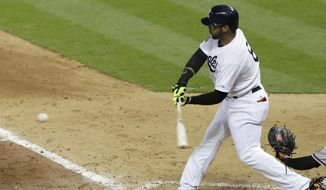 Houston Astros' Jonathan Villar swings for an RBI ground-rule double against the Baltimore Orioles in the seventh inning of Major League baseball's annual Civil Rights Game Friday, May 30, 2014, in Houston. (AP Photo/Pat Sullivan)