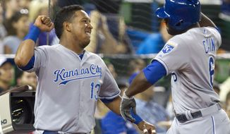 Kansas City Royals' Lorenzo Cain, right, is congratulated by Salvador Perez after he hit a two-run home run off Toronto Blue Jays starting pitcher J.A. Happ during the eighth inning of a baseball game in Toronto on Friday, May 30, 2014. (AP Photo/The Canadian Press, Fred Thornhill)