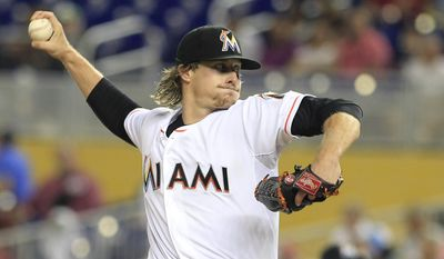 Miami Marlins starting pitcher Tom Koehler throws against the Atlanta Braves in the first inning during their baseball game in Miami, Friday, May 30, 2014. (AP Photo/Joe Skipper)