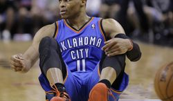 Oklahoma City Thunder's Russell Westbrook (0) sits on the court after he was fouled during the second half of Game 5 of the Western Conference finals NBA basketball playoff series against the San Antonio Spurs, Thursday, May 29, 2014, in San Antonio. San Antonio won 117-89. (AP Photo/Eric Gay)