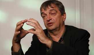 French former FIFA executive Jerome Champagne gestures during an interview with the Associated Press in Paris, Thursday, May 29, 2014. Jerome Champagne is one of the front-runners to challenge Sepp Blatter for the FIFA presidency in 2015 and refused to accept that hoping to unseat Blatter, his former boss, was a lost cause. (AP Photo/Francois Mori)