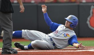 Kansas' Justin Protacio slides into home to score a run in the second inning of an NCAA college baseball regional tournament game against Kentucky in Louisville, Ky., Friday, May 30, 2014. (AP Photo/Timothy D. Easley)