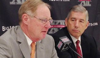 Oklahoma State President and Chairman of the Big 12 board of directors Burns Hargis, , left, and Big 12 Commissioner Bob Bowlsby, talk at the end of the Big 12 meetings at the Four Seasons Resort and Hotel in Irving, Texas, on Friday, May 30, 2014. (AP Photo/Stephen Hawkins)