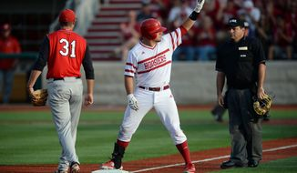Indiana's Kyle Schwarber acknowledges the dugout and crowd after his triple during an NCAA college regional baseball game against Youngstown State in Bloomington, Ind. Friday, May 30, 2014. Youngstown State's Matt Sullivan covers third base. (AP Photo/The Herald-Times, Chris Howell)