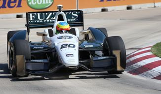 Mike Conway takes a turn during a practice session for the IndyCar Detroit Grand Prix auto race on Belle Isle in Detroit, Friday, May 30, 2014. (AP Photo/Bob Brodbeck)