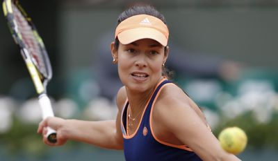 CORRECTING WINNER'S FIRST NAME TO ANA - Serbia's Ana Ivanovic returns the ball during the second round match of the French Open tennis tournament against Ukraine's Elina Svitolina at the Roland Garros stadium, in Paris, France, Thursday, May 29, 2014. (AP Photo/Darko Vojinovic)