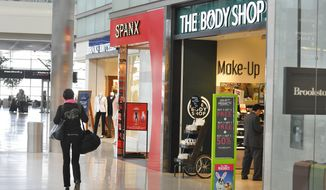 ** FILE ** In a April 21, 2014, photo, new shops open up along the first floor of concourse A in McNamara Terminal at the Detroit Metropolitan Airport in Romulus, Mich. (AP Photo/The Detroit News, Daniel Mears)