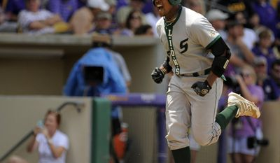 Southeastern University right fielder Andrew Godbold reacts as he rounds the bases after hitting a home run against LSU during an NCAA college baseball regional tournament game in Baton Rouge, La., Friday May 30, 2014. (AP Photo/ Stacy Revere)