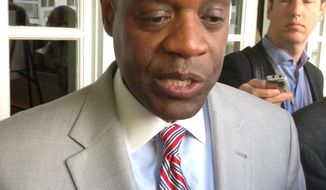 """Detroit emergency manager Kevyn Orr speaks with reporters after addressing the Mackinac Policy Conference on Friday, May 30, 2014 on Mackinac Island, Mich. Orr said city retirees and workers considering a deal to cut their pensions risk much steeper reductions if they make a """"protest vote"""" over a restructuring plan to help Detroit out of bankruptcy. (AP Photo/David Eggert)"""