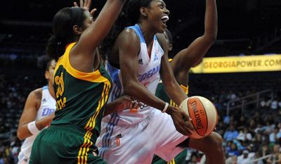 Atlanta Dream's Tiffany Hayes drives past Seattle Storm's Camille Little during the first half of a WNBA basketball game Friday, May 30, 2014, in Atlanta. (AP Photo/Atlanta Journal Constitution, Brant Sanderlin) GWINNETT OUT  MARIETTA OUT   LOCAL TV OUT (WXIA, WGCL, FOX 5)