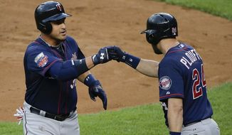 Minnesota Twins' Oswaldo Arcia (31) is greeted by teammate Trevor Plouffe (24) after hitting a solo home run during the second inning of a baseball game against the New York Yankees, Friday, May 30, 2014, in New York. (AP Photo/Julie Jacobson)