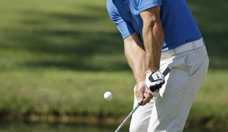 Paul Casey chips to the ninth green during the second round of the Memorial golf tournament on Friday, May 30, 2014, in Dublin, Ohio. (AP Photo/Darron Cummings)