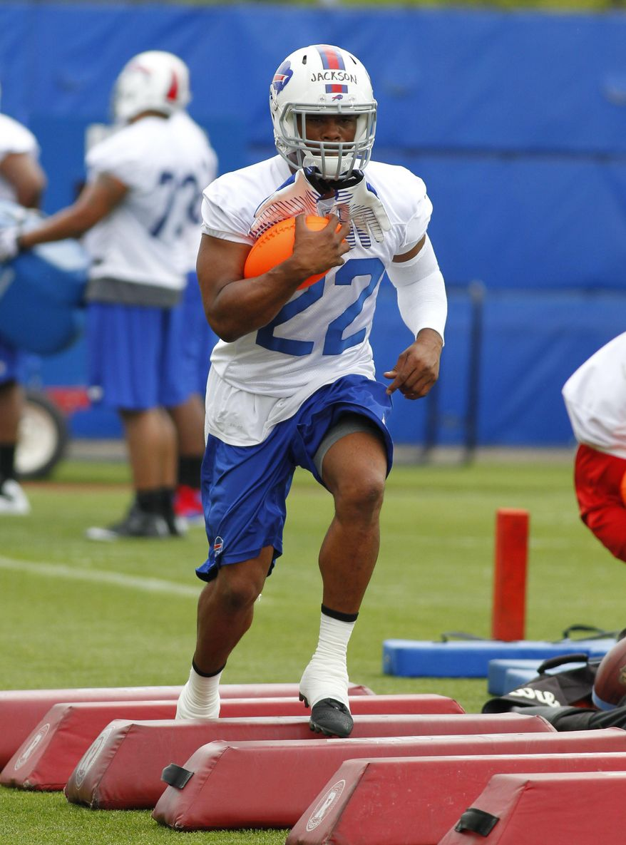 Buffalo Bills running back Fred Jackson (22) takes part in drills during an NFL football organized team activity in Orchard Park, N.Y., Thursday, May 29, 2014. (AP Photo/Bill Wippert)
