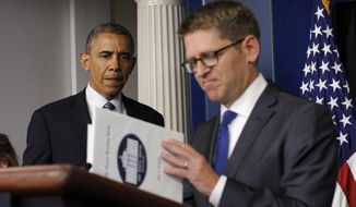 ** FILE ** White House press secretary Jay Carney closes his briefing book as President Barack Obama makes a surprise visit to the Brady Press Briefing Room in Washington, Friday, May 30, 2014, to announce during the daily press briefing that Carney will be stepping down in June. (AP Photo/Susan Walsh)