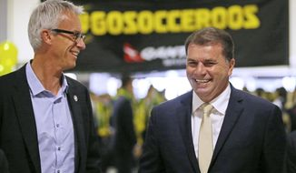 Australia's soccer team head coach Ange Postecoglou, right, and CEO of Football Federation Australia David Gallop, arrive at Sydney Airport as they prepare to travel to Brazil for the World Cup soccer tournament in Sydney, Wednesday, May 28, 2014. Australia are in Group B along with Spain, the Netherlands and Chile. (AP Photo/Rick Rycroft)