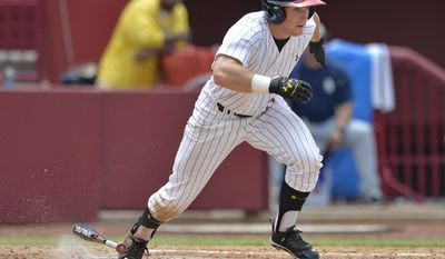 Maryland's Tim Lewis heads to first on a hit against Old Dominion during an NCAA college baseball tournament regional game in Columbia, S.C., Friday, May 30, 2014. (AP Photo/Richard Shiro)