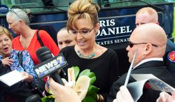 ** FILE ** Former Alaska Gov. Sarah Palin leaves the Jones County Junior College Fine Arts Center in Ellisville, Miss., after headlining a campaign rally for U.S. Senate candidate Chris McDaniel on Friday, May 30, 2014. McDaniel is challenging Republican Sen. Thad Cochran. (AP Photo/The Hattiesburg American, Kelly Price)
