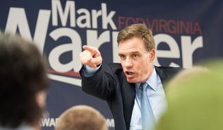 U.S. Senator Mark Warner talks to people at Matchbox Reality during the start of his re-election campaign Friday, May 30, 2014, in Harrisonburg, Va. Warner is a former governor who is seeking a second term in the Senate.  (AP Photo/The Daily News-Record, Nikki Fox)