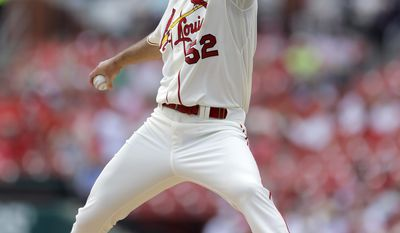 St. Louis Cardinals starting pitcher Michael Wacha throws during the first inning of a baseball game against the San Francisco Giants Saturday, May 31, 2014, in St. Louis. (AP Photo/Jeff Roberson)