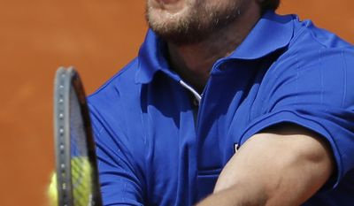 Italy's Andreas Seppi returns the ball during the third round match of the French Open tennis tournament against Spain's David Ferrer at the Roland Garros stadium, in Paris, France, Saturday, May 31, 2014. (AP Photo/Darko Vojinovic)