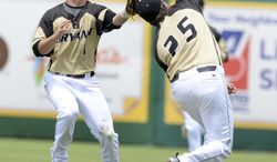 Bryant's Cole Fabio (1) and Robby Rinn (25) both chase after a popup until Rinn makes the catch against Southeastern Louisiana on Saturday, May 31, 2014, during the first round of an NCAA college baseball regional tournament in Baton Rouge, La. (AP Photo/The Baton Rouge Advocate, Hilary Scheinuk) NO SALES; MAGAZINES OUT; INTERNET OUT;TV OUT; NO FOREIGNS. LOUISIANA BUSINESS INC. OUT (INCLUDING GREATER BATON ROUGE BUSINESS REPORT; 225; 10/12; INREGISTER; LBI CUSTOM MAGS OUT/  INTERNET OUT/ ONLINE OUT/ NO SALES/  TV OUT/  FOREIGN OUT/ LOUISIANA BUSINESS INC. OUT (INCLUDING GREATER BATON ROUGE BUSINESS REPORT, 225, 10/12, INREGISTER, LBI CUSTOM PUBLICATIONS) MANDATORY CREDIT THE ADVOCATE