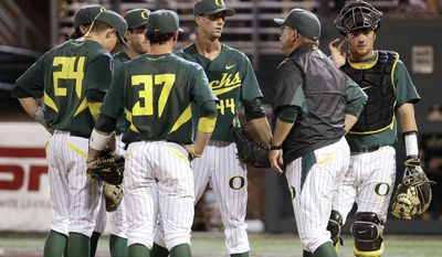 Oregon starting pitcher Jeff Gold (44) is taken out by coach George Horton, second from right, during the fifth inning of an NCAA college baseball tournament regional game against Vanderbilt on Saturday, May 31, 2014, in Nashville, Tenn. (AP Photo/Mark Humphrey)