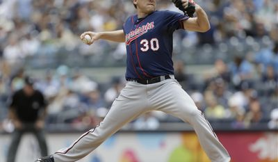 Minnesota Twins' Kevin Correia delivers a pitch during the first inning of a baseball game against the New York Yankees Saturday, May 31, 2014, in New York.  (AP Photo/Frank Franklin II)
