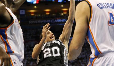 As he falls to the floor, San Antonio Spurs guard Manu Ginobili (20) shoots between Oklahoma City Thunder's Kendrick Perkins, left, and Nick Collison (4) in the second half of Game 6 of the Western Conference finals NBA basketball playoff series in Oklahoma City, Saturday, May 31, 2014. (AP Photo/Sue Ogrocki)