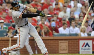 San Francisco Giants' Michael Morse follows through on a broken-bat single against the St. Louis Cardinals in the first inning in a baseball game on Friday, May 30, 2014, at Busch Stadium in St. Louis. (AP Photo/Bill Boyce)
