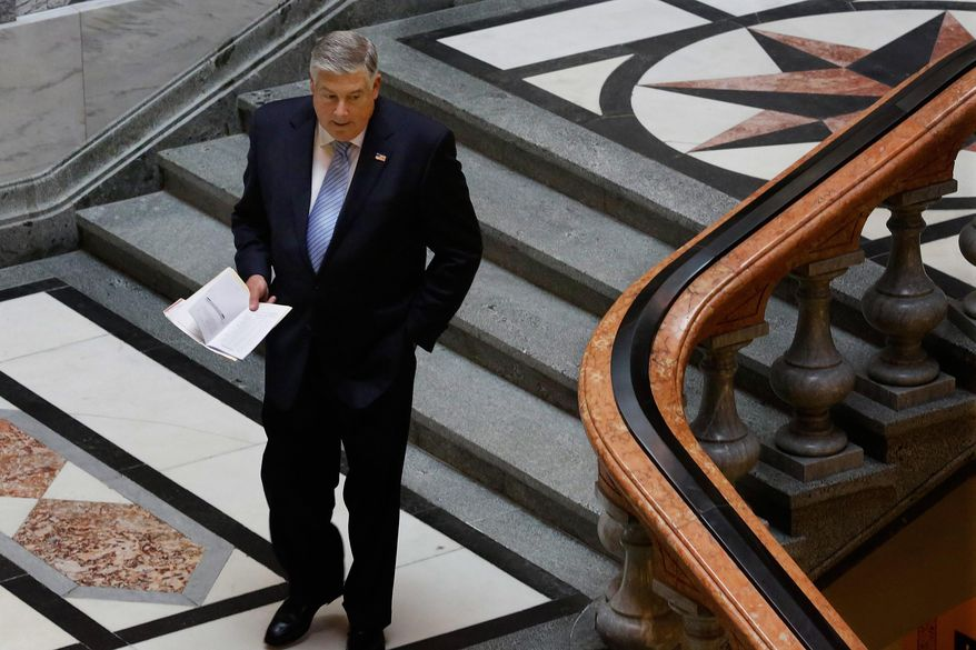 Illinois state Sen. Kirk Dillard, R-Westmont, leaves the Senate chambers at the state Capitol Friday, May  30, 2014, in Springfield Ill. (AP Photo/Seth Perlman)