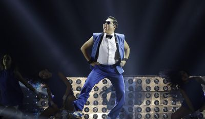 """FILE - In this Sunday, Dec. 22, 2013, file photo, South Korean rapper PSY performs during his concert """"All Night Stand"""" in Seoul, South Korea. The Korean pop star's surprise hit has become the first video on YouTube to surpass 2 billion views. (AP Photo/Lee Jin-man, File)"""