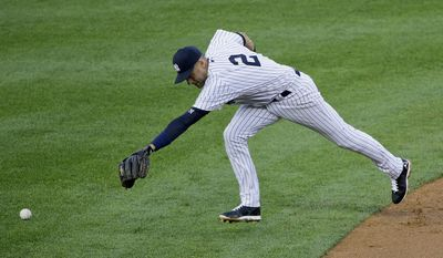 New York Yankees shortstop Derek Jeter cannot reach a base hit by Minnesota Twins Kurt Suzuki during the second inning on Friday, May 30, 2014, in New York. (AP Photo/Julie Jacobson)