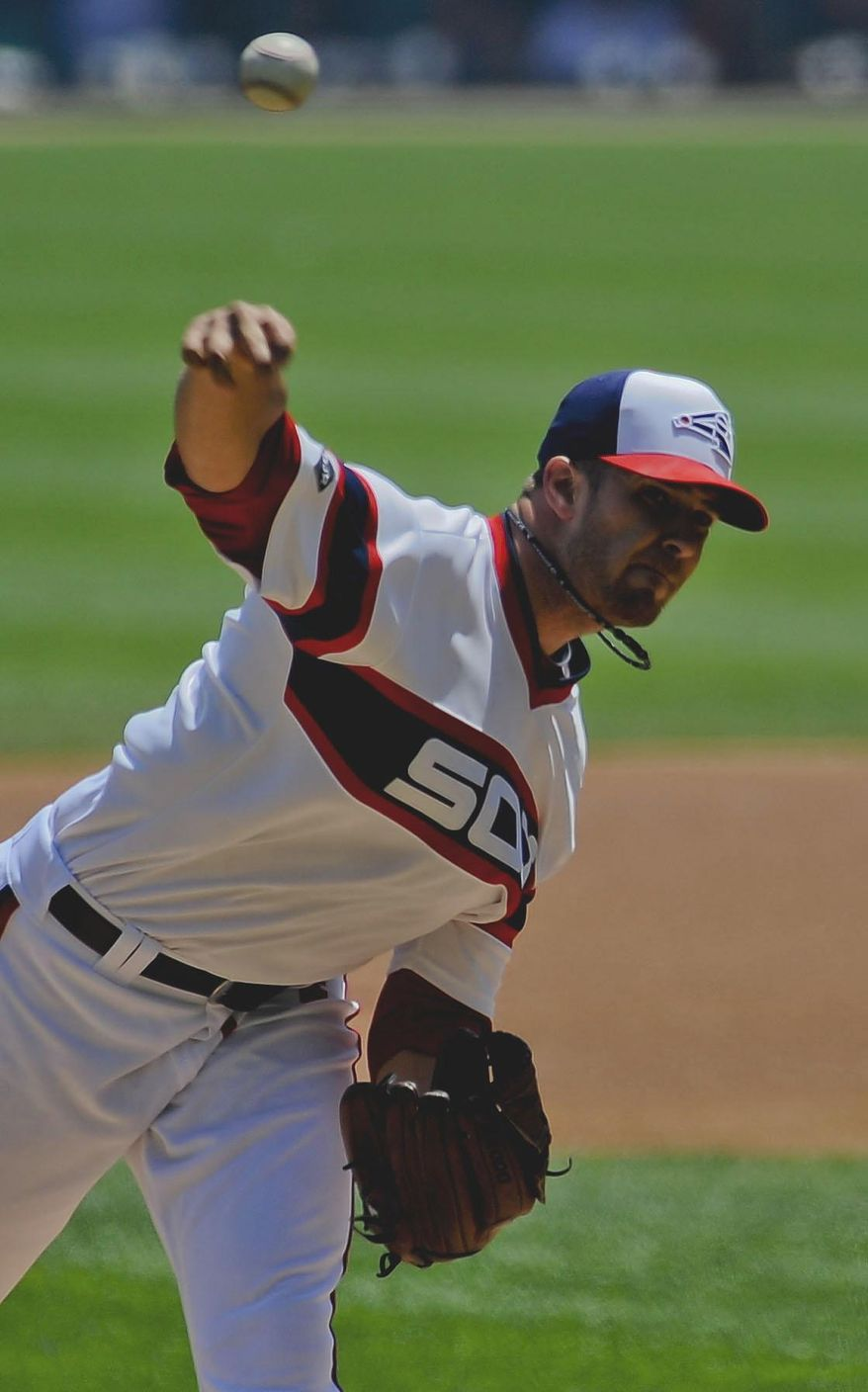 Chicago White Sox starting pitcher Andre Rienzo delivers during the first inning of an interleague baseball game against the San Diego Padres on Saturday, May 31, 2014, in Chicago. (AP Photo/Matt Marton)