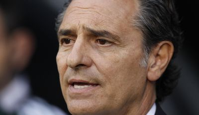 Italy's head coach Cesare Prandelli looks on from the dugout before the start of their international friendly soccer match against Republic of Ireland at Craven Cottage, London, Saturday, May 31, 2014. (AP Photo/Sang Tan)