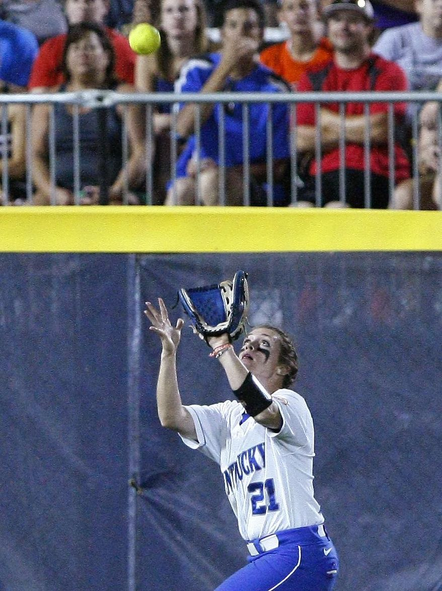 Kentucky left fielder Emily Jolly catches an Alabama ball to left field during the second inning of an NCAA Women's College World Series softball tournament game in Oklahoma City, Friday, May 30, 2014. (AP Photo/Alonzo Adams)