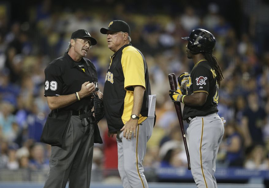 Pittsburgh Pirates manager Clint Hurdle, center, argues with home plate umpire Paul Nauert after Andrew McCutchen, right, struck out during the third inning of a baseball game against the Los Angeles Dodgers on Friday, May 30, 2014, in Los Angeles. (AP Photo/Jae C. Hong)