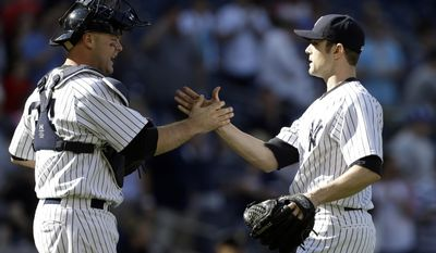 New York Yankees relief pitcher David Robertson celebrates with catcher Brian McCann, left, after their 3-1 win in a baseball game against the Minnesota Twins Saturday, May 31, 2014, in New York.  (AP Photo/Frank Franklin II)