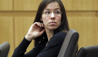 FILE - This Jan. 9, 2013 file photo shows Jodi Arias appearing for her trial in Maricopa County Superior court in Phoenix. A judge has denied a motion from Arias' defense team to have the death penalty removed as a sentencing option. In court documents filed Friday, May 30, 2014, Judge Sherry Stephens says Arias' attorneys showed no evidence that banning a defense aide from making jail visits last March prejudiced the murder case. (AP Photo/Matt York, File)