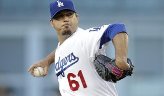 Los Angeles Dodgers starting pitcher Josh Beckett throws against the Pittsburgh Pirates during the first inning of a baseball game Friday, May 30, 2014, in Los Angeles. (AP Photo/Jae C. Hong)
