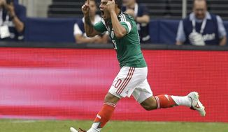 Mexico's Luis Montes celebrates after scoring against Ecuador in the first half of a friendly soccer match, Saturday, May 31, 2014, in Arlington, Texas.  (AP Photo/Tony Gutierrez)