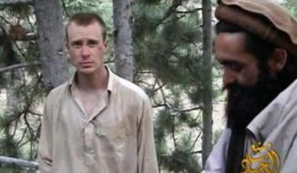 "FILE - This file image provided by IntelCenter on Dec. 8, 2010, shows a frame grab from a video released by the Taliban containing footage of a man believed to be Bowe Bergdahl, left.  Saturday, May 31, 2014, U.S. officials say Bergdahl, the only American soldier held prisoner in Afghanistan has been freed and is in U.S. custody. The officials say his release was part of a negotiation that includes the release of five Afghan detainees held in the U.S. prison at Guantanamo Bay, Cuba. (AP Photo/IntelCenter, File)  MANDATORY CREDIT: INTELCENTER; NO SALES; EDS NOTE: ""INTELCENTER"" AT LEFT TOP CORNER ADDED BY SOURCE"