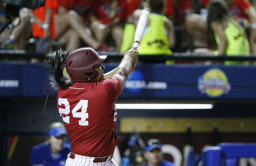 Alabama's Leona Lafaele hits a two-run home run against Kentucky during the second inning of an NCAA Women's College World Series softball tournament game in Oklahoma City, Friday, May 30, 2014. (AP Photo/Alonzo Adams)