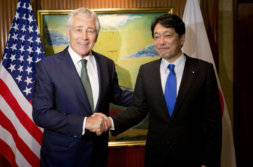 U.S. Defense Secretary Chuck Hagel, left, with Japanese Defense Minister Itsunori Onodera pose for a photo before the start of their meeting Saturday, May 31, 2014 in Singapore. Hagel traveled to Singapore to attend the 13th Asia Security Summit. (AP Photo/Pablo Martinez Monsivais, Pool)