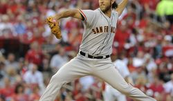 San Francisco Giants' starting pitcher Madison Bumgarner throws against the St. Louis Cardinals in the first inning in a baseball game on Friday, May 30, 2014, in St. Louis. (AP Photo/Bill Boyce)